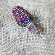 Scarab beetle made in seed beads and wire