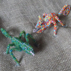 Beaded chameleons with tongues out