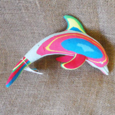 Dolphin hand carved from recycled flip flops