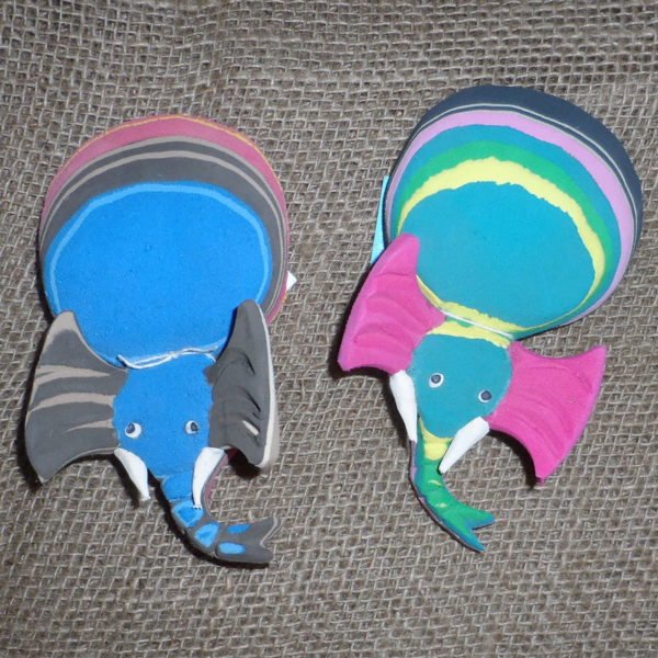 Elephant shaped door stops crafted from recycled flip flops